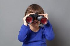 Kid exploration concept with binoculars Stock Photo