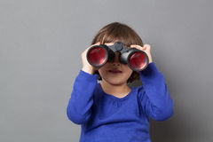 Kid exploration concept for curious 4-year old child. Kid exploration concept - curious 4-year old child having fun in looking away through binoculars for Stock Photos
