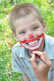 Kid face mask paint Stock Images