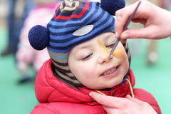 Kid with face painting Stock Images