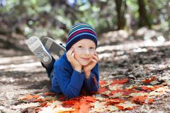 Kid at fall Royalty Free Stock Images