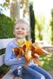 Kid at fall Stock Images