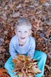 Kid at fall Stock Photography