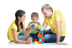 Kid with family play building blocks. Kid and his family play building blocks Stock Photography