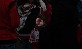 MADRID, DECEMBER 09 - Kid fan of River Plate with his face painted, in the final of the Copa Libertadores at the Bernabéu stadium royalty free stock photo
