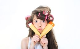 Kid fashion, cosmetics. Cute teen putting cream on her face. Little girl is holding a tube for the cream. Skincare stock photos
