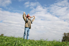 Kid on father's sholders Stock Image