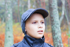 Kid fear face forest fall portrait. Outdoor Stock Image