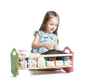 Kid feeding and playing with kitten cat Royalty Free Stock Images