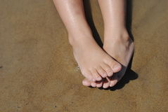 Kid feet over sand Royalty Free Stock Photo