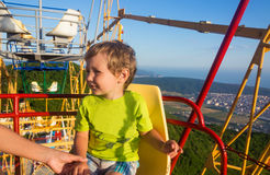 Kid on the Ferris wheel high Royalty Free Stock Images