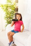 Kid filming home video Stock Photography
