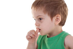 Kid with finger in his mouth Stock Image