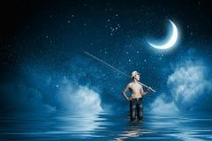 Kid fisherman Stock Photo