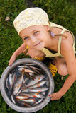 Kid and fishes Stock Photos