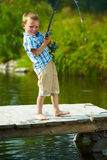 Kid fishing stock images