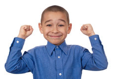 Kid with fists raised, victory. Happy seven-year-old Hispanic boy with hands raised in victory or success, isolated on pure white background Stock Photos