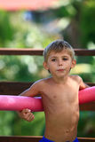 Kid with float. Playing at pool royalty free stock photo