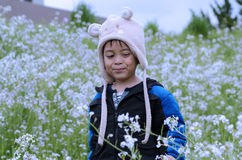 Kid among the flowers Royalty Free Stock Images