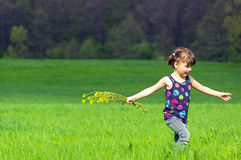 Kid with flowers outdoors Royalty Free Stock Photography
