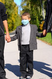 Kid in the flu mask Royalty Free Stock Image