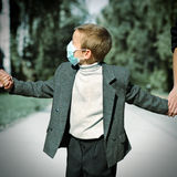Kid in the Flu Mask Royalty Free Stock Photos