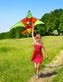Kid flying kite outdoor. Royalty Free Stock Photo