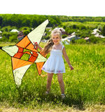 Kid flying kite outdoor. Stock Photo