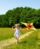 Kid flying kite outdoor. Royalty Free Stock Image