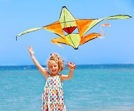Kid flying kite outdoor. Stock Photos