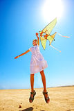 Kid flying kite outdoor. Stock Photography