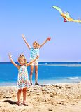 Kid flying kite outdoor. Royalty Free Stock Images
