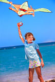 Kid flying kite outdoor Stock Image
