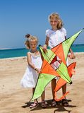 Kid flying kite outdoor Stock Images