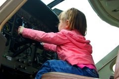 Kid flying the plane Royalty Free Stock Image