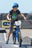 A kid at the FMX (Freestyle Motocross) junior competition Royalty Free Stock Photos