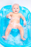 Kid in foam Stock Photo