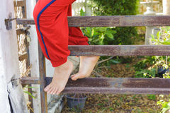 Kid foot climb on the rust iron bar Stock Image