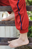 Kid foot climb on the rust iron bar Stock Photography