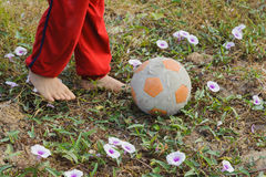 Kid foot play football Stock Photography