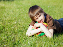 Kid with football Stock Images
