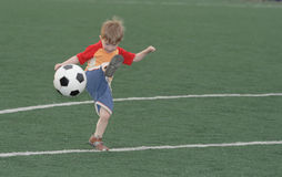 The kid - football player Stock Image