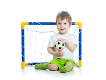 Kid football player holding soccer ball Royalty Free Stock Photography