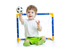 Kid football player holding soccer ball Stock Images