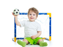 Kid football player holding soccer ball Stock Image