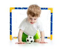 Kid football player with soccer ball Royalty Free Stock Photography