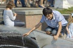 Kid on the fountain Royalty Free Stock Photo