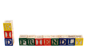 Kid Friendly. The words kid friendly spelled out using wooden letter blocks, isolated against a white background Royalty Free Stock Photography