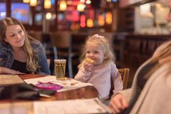 Kid friendly dining at a family restaurant. Family eating at a kid friendly restaurant royalty free stock photos