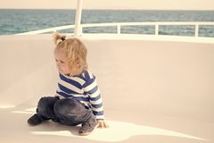 Kid friendly features. Family vacation cruise ship all inclusive tour. Kid boy toddler travelling sea cruise. Child in. Striped shirt looks like young sailor stock photography
